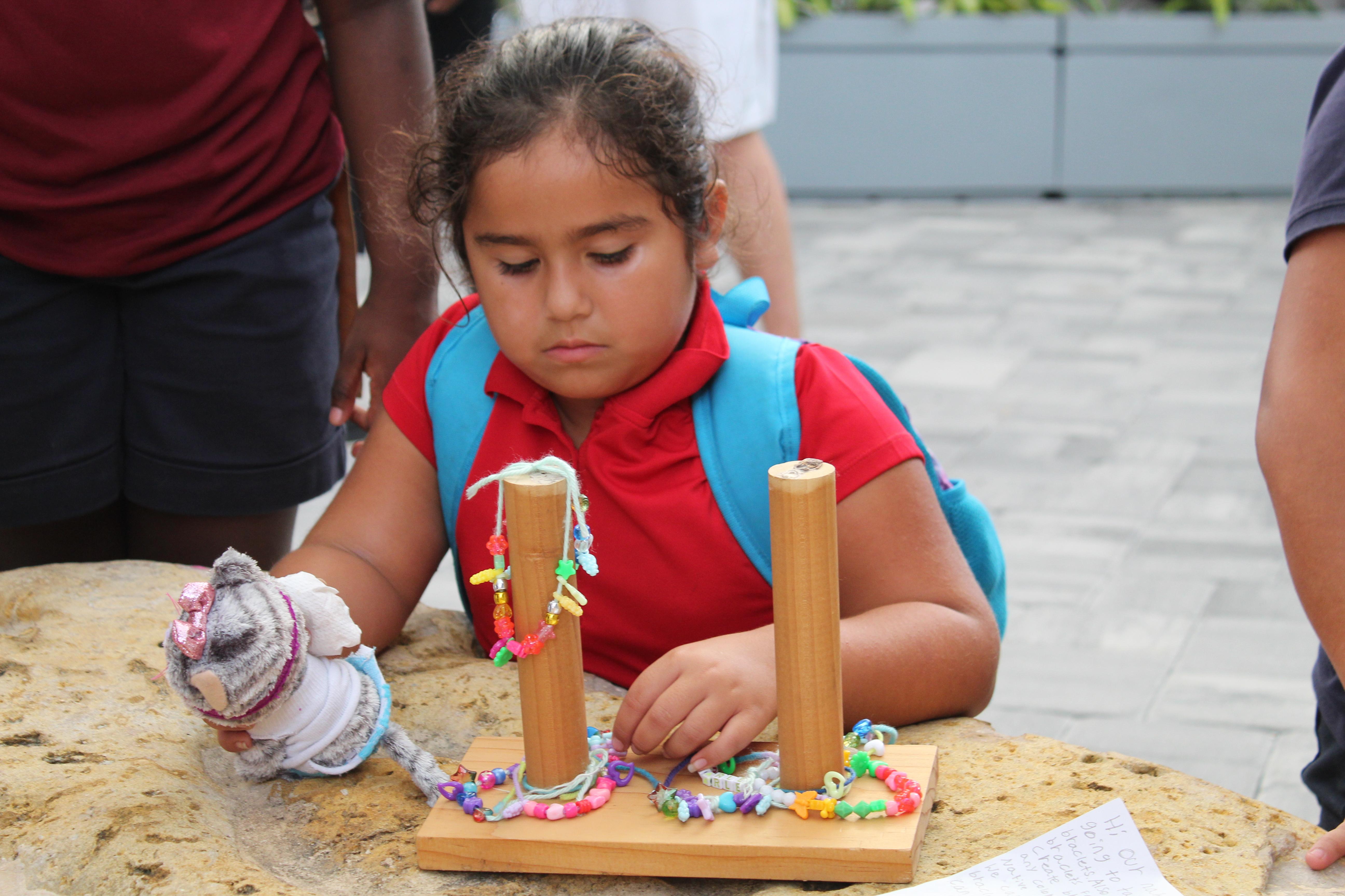 gift setting up her handmade bracelets