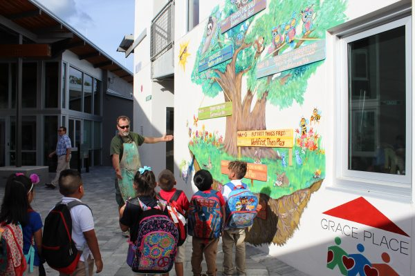 artist shows mural to students
