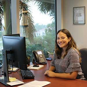Arletys at her desk