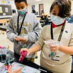 middle school kids making kindness rocks
